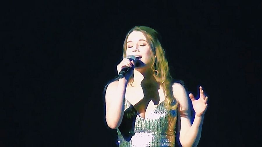 "Glenbrook North senior Gemma Gardner sings ""Stand By You"" at the high school's annual variety show, ""Vision."""
