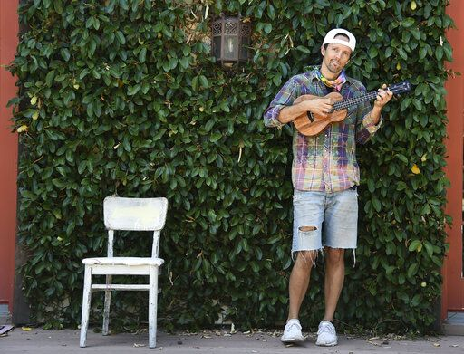 In this June 16, 2020 photo, singer-songwriter Jason Mraz poses for a portrait at his home in Oceanside, Calif., to promote his new reggae album 'œLook for the Good.'� The two-time Grammy-winner is donating all earnings from sales and streams of his album, including his $250,000 advance, to groups advancing equality and justice.