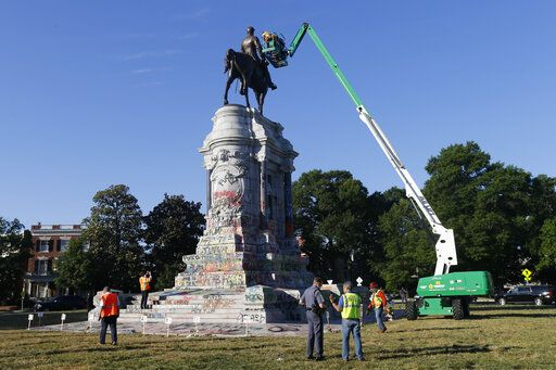EDS NOTE: OBSCENITY - An inspection crew from the Virginia Department of General Services inspect the statue of Confederate Gen. Robert E. Lee on Monument Avenue Monday June. 8, 2020, in Richmond, Va. Virginia Gov. Ralph Northam has ordered the removal of the statue.