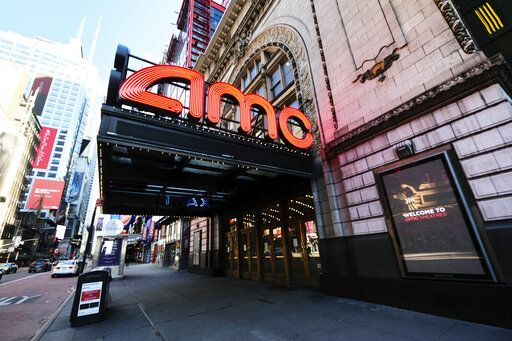 FILE - In this May 13, 2020 file photo, AMC Empire 25 theatre appears on 42nd Street in New York. The nation's largest movie theater chain changed its position on mask-wearing less than a day after the company became a target on social media for saying it would defer to local governments on the issue. AMC Theaters CEO Adam Aron said Friday that its theaters will require patrons to wear masks upon reopening, which will begin in July. (Photo by Evan Agostini/Invision/AP, File)