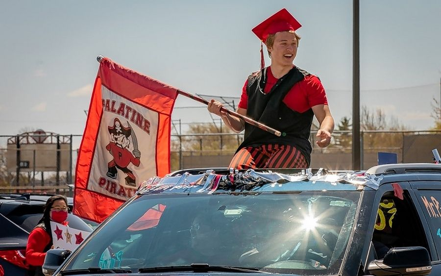 Palatine High School graduate and academic scholar Patrick Angelaccio takes part in the senior class drive at the school. The drive replaced many of the other commencement traditions.