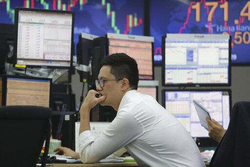 A currency trader watches monitors at the foreign exchange dealing room of the KEB Hana Bank headquarters in Seoul, South Korea, Monday, June 22, 2020. Shares were mostly higher in Asia on Monday despite reports that the number of coronavirus cases in the U.S. has surged sharply.