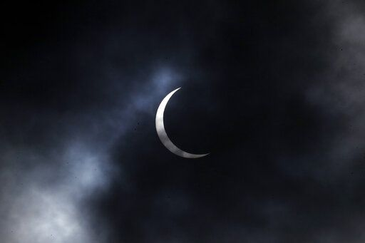 The sun forms crescent during solar eclipse in Kathmandu, Nepal, Sunday, June 21, 2020.