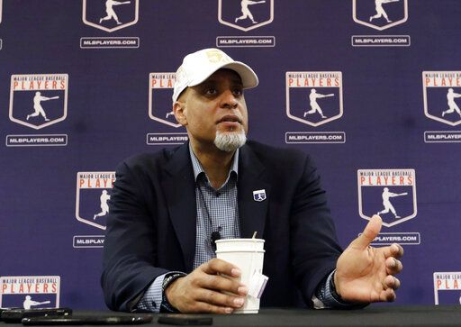 FILE - In this Feb. 19, 2017, file photo, Major League Players Association Executive Director Tony Clark, answers questions at a news conference in Phoenix. Commissioner Rob Manfred says there might be no major league season after a breakdown in talks between teams and the union on how to split up money in a season delayed by the coronavirus pandemic. The league also said several players have tested positive for COVID-19. Two days after union head Clark declared additional negotiations futile, Deputy Commissioner Dan Halem sent a seven-page letter to players' association chief negotiator Bruce Meyer asking the union whether it will waive the threat of legal action and tell MLB to announce a spring training report date and a regular season schedule.