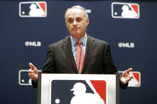 FILE - In this Nov. 21, 2019, file photo, baseball commissioner Rob Manfred speaks to the media at the owners meeting in Arlington, Texas. The chance that there will be no Major League Baseball season increased substantially Monday, June 15, 2020, when the commissioner's office told the players' association it will not proceed with a schedule amid the coronavirus pandemic unless the union waives its right to claim management violated a March agreement between the feuding sides.