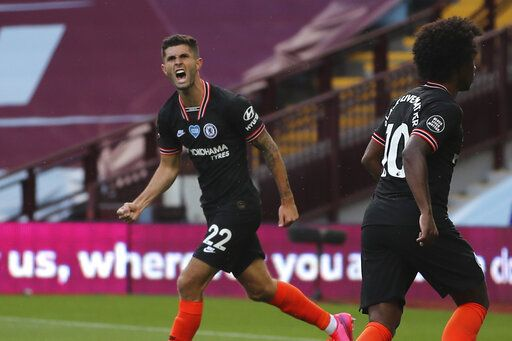 Chelsea's Christian Pulisic celebrates after scoring his side's opening goal during the English Premier League soccer match between Aston Villa and Chelsea at the Villa Park stadium in Birmingham, England, Sunday, June 21, 2020. (Molly Darlington/Pool via AP)