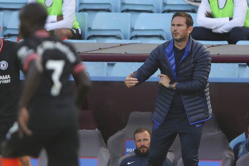 Chelsea's head coach Frank Lampard gestures during the English Premier League soccer match between Aston Villa and Chelsea at the Villa Park stadium in Birmingham, England, Sunday, June 21, 2020. (Molly Darlington/Pool via AP)