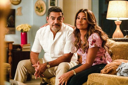 "In this image released by ABC, Carlos Gomez, left, and Lisa Vidal appear in a scene from ""The Baker and the Beauty."" Fans have launched a petition drive to find the sitcom a new home after it was canceled by ABC. (Laura Magruder/ABC via AP)"