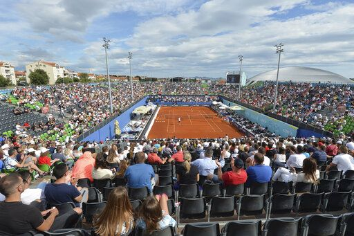 Spectators watch a tennis match during an exhibition tournament in Zadar, Croatia, Sunday, June 21, 2020. Tennis player Grigor Dimitrov says he has tested positive for COVID-19 and his announcement led to the cancellation of an exhibition event in Croatia where Novak Djokovic was scheduled to play on Sunday.