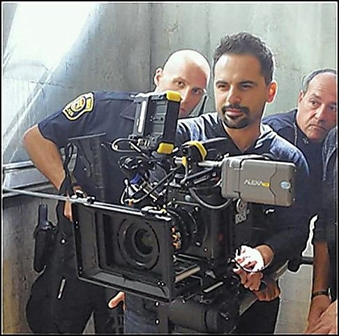 "One of the ways filmmaker Sam Logan Khaleghi kept his costs in control for his new movie was using actual police officers to play those roles in his movie, ""Devil's Night: Dawn of the Nain Rouge."""