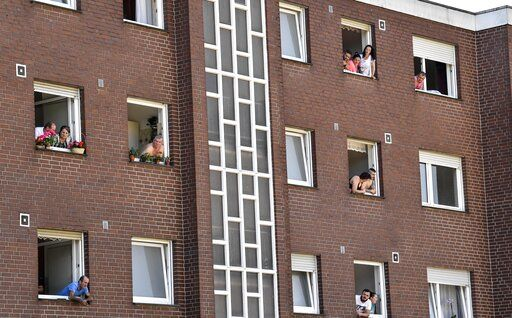Toennies employees and their families are quarantined in their apartments behind fences in Verl, Germany, Tuesday, June 23, 2020. Following the corona outbreak at meat processor Toennies in Rheda-Wiedenbrueck, the federal state authorities are massively restricting public life in the Guetersloh district with a lockdown.