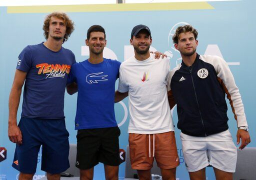 FILE - In this Friday June 12, 2020 file photo Serbia's Novak Djokovic, second left, poses with Germany's Alexander Zverev, left, Bulgaria's Grigor Dimitrov, second right, and Austria's Dominic Thiem after a press conference prior a a charity tournament Adria Tour, in Belgrade, Serbia. Novak Djokovic has tested positive for the coronavirus after taking part in a tennis exhibition series he organized in Serbia and Croatia. Grigor Dimitrov, a three-time Grand Slam semifinalist from Bulgaria, said Sunday he tested positive.