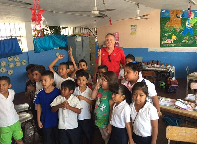 Lonny Lemon, back, with elementary school students in Puerta Vallerta, Mexico. Lemon, who retired Wednesday after eight years as superintendent at Oak Grove School in Green Oaks, has collected and delivered thousands of pencils to the school.