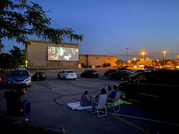 Viewers watch from their cars as a movie is shown at Marcus Cinema in Pickerington, Ohio. Outdoor double features will begin Friday at the Marcus Cinema in Elgin.