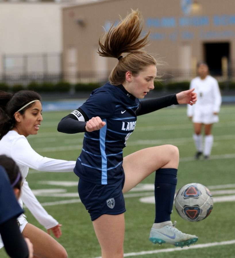 Lake Park's Emma Thorne corrals the ball against Streamwood during varsity girls soccer at Lake Park High School's West Campus on Monday.