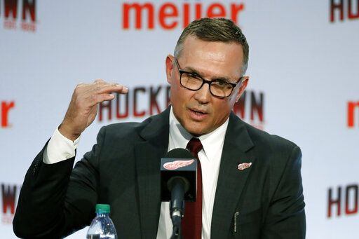 FILE - In this April 19, 2019, file photo, Steve Yzerman answers a question during an NHL hockey news conference where he was introduced as the new executive vice president and general manager of the Detroit Red Wings, in Detroit. The Detroit Red Wings desperately hope to win the NHL draft lottery, giving them the first shot to perhaps select Canadian winger Alexis Lafreniere.