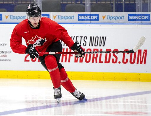 FILE - In this Jan. 1, 2020, file photo, Canada's Alexis Lafreniere during during  practice at the World Junior Hockey Championships in Ostrava, Czech Republic. The Detroit Red Wings could actually benefit from an adjusted draft lottery that gives him better odds at the top pick, likely Alexis Lafreniere. (Ryan Remiorz/The Canadian Press via AP, FIle)