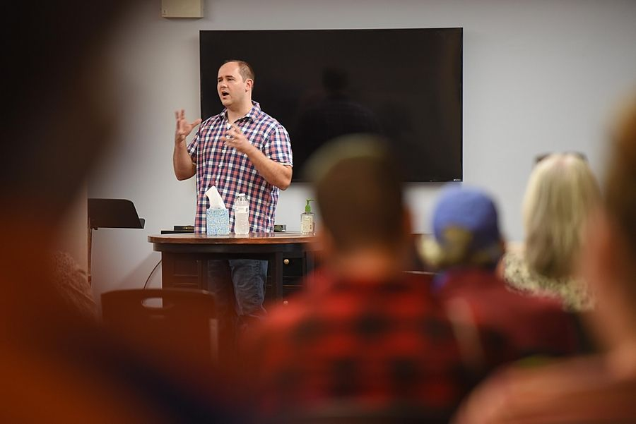 Joe Misek, director of Street Reach, speaks at Elgin's Vineyard Church on Friday at a memorial service for Doug Henke, a homeless man who wrote a blog about his life.