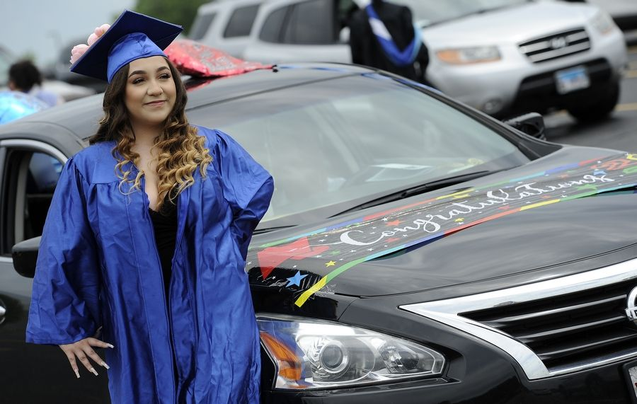 Dundee-Crown grad Katarina Munguia, 18, of Carpentersville poses next to her decked out car in the parking lot at the Sears Centre in Hoffman Estates.