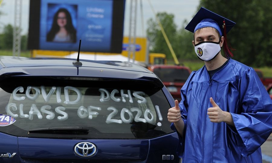 Dundee-Crown grad Dylan Morvay, 19, of West Dundee poses next to his car Friday afternoon at the Sears Centre parking lot in Hoffman Estates.