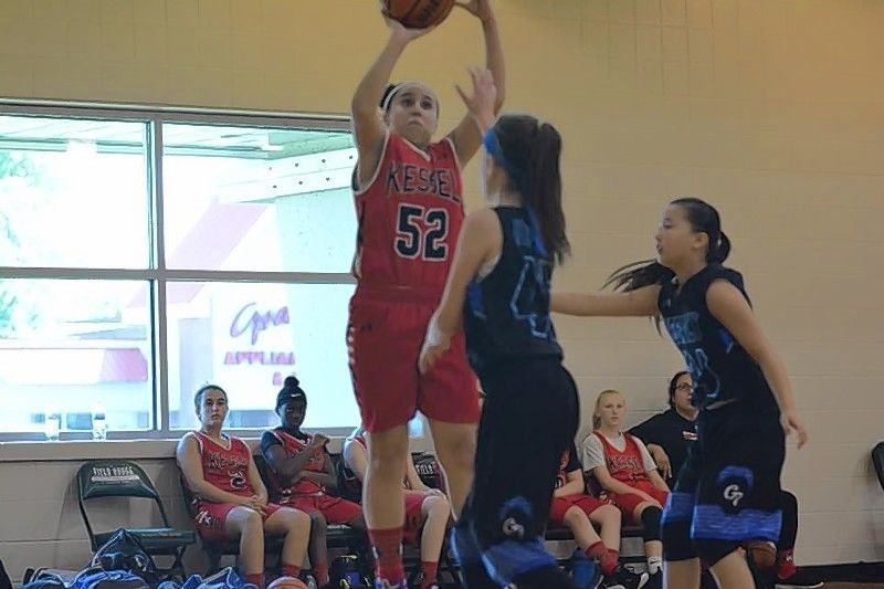 Izzy Robinson Klemm, an incoming freshman at Warren Township High School, puts up a shot playing for Kessel Heat AAU.