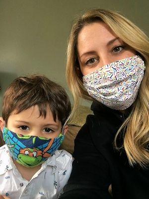 """Lindsay Combs, of East Dundee, with her son Kane, 4, who along with his younger brother Conway, 2, has been wearing masks eight hours a day, five days a week since St. Patrick's Day while in day care. """"If a 2-year-old can do it, surely your school-age children will be fine,"""" Combs says of new state guidelines requiring K-12 students wear masks when schools start this fall."""
