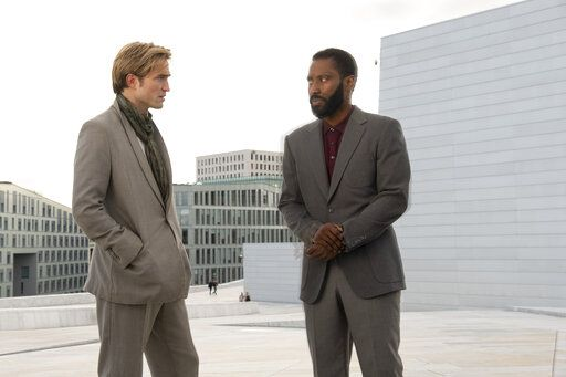 "This image released by Warner Bros. Entertainment shows Robert Pattinson, left, and John David Washington in a scene from ""Tenet."" Warner Bros. says it is delaying the release of Christopher Nolan's sci-fi thriller 'œTenet'� until Aug. 12. (Melinda Sue Gordon/Warner Bros. Entertainment via AP)"