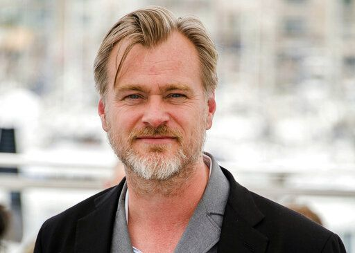 FILE - In this May 12, 2018, file photo, director Christopher Nolan poses during a photo call at the 71st international film festival in Cannes, southern France. Warner Bros. announced late Thursday, June 25, that it is delaying the release of Nolan's sci-fi thriller 'œTenet'� from July 31 until Aug. 12, a date the studio says will give it more flexibility to get the film in theaters despite uncertainty caused by a surge in coronavirus cases in certain locales. (Photo by Arthur Mola/Invision/AP, File)