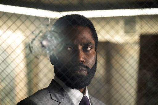 "This image released by Warner Bros. Entertainment shows John David Washington in a scene from ""Tenet."" Warner Bros. says it is delaying the release of Christopher Nolan's sci-fi thriller 'œTenet'� until Aug. 12. (Melinda Sue Gordon/Warner Bros. Entertainment via AP)"