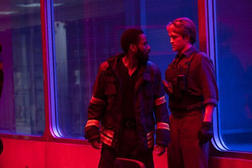 "This image released by Warner Bros. Entertainment shows Robert Pattinson, right, and John David Washington in a scene from ""Tenet."" Warner Bros. says it is delaying the release of Christopher Nolan's sci-fi thriller 'œTenet'� until Aug. 12. (Melinda Sue Gordon/Warner Bros. Entertainment via AP)"