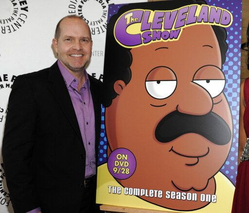 "FILE - In this Sept. 23, 2010 file photo, actor and show co-creator Mike Henry appears with signage for his animated series ""The Cleveland Show"" at a panel discussion at The Paley Center for Media in Beverly Hills, Calif. The show was a spin-off from the long-running series ""Family Guy."" Henry, announced Friday, June 26, that he will no longer voice the black character Cleveland Brown on ""Family Guy."" The spin-off series was canceled after its fourth season in 2013."