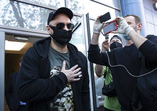 Russian film and theater director Kirill Serebrennikov, wearing a face mask to protect against coronavirus, leaves the Meshchansky court after hearings in Moscow, Russia, Friday, June 26, 2020.