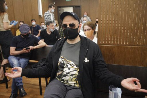 Russian film and theater director Kirill Serebrennikov wearing a protective face mask sits prior to a court hearing at the Meshchansky court in Moscow, Russia, Friday, June 26, 2020. A court in Moscow is expected to deliver a verdict on Friday to the acclaimed theater director accused of embezzling state funds, in a case widely seen as politically motivated.