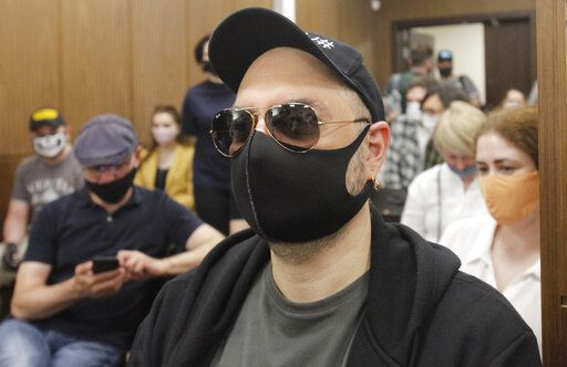 Russian film and theater director Kirill Serebrennikov wearing a protective face mask sits prior to his court hearing at the Meshchansky court in Moscow, Russia, Friday, June 26, 2020. A court in Moscow is expected to deliver a verdict on Friday to the acclaimed theater director accused of embezzling state funds, in a case widely seen as politically motivated.