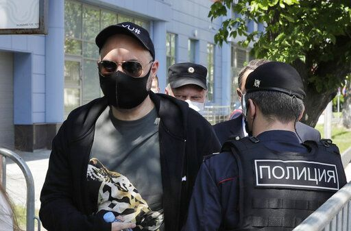 Russian film and theater director Kirill Serebrennikov, left, wearing a face mask to protect against coronavirus arrives for a court hearing at the Meshchansky court, in Moscow, Russia, Friday, June 26, 2020. A court in Moscow is expected to deliver a verdict on Friday to the acclaimed theater director accused of embezzling state funds, in a case widely seen as politically motivated.