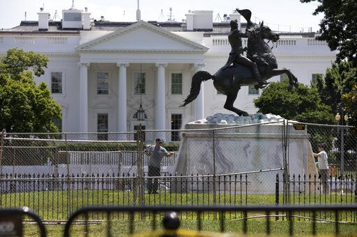 The base of the statue of former president Andrew Jackson is power washed inside a newly closed Lafayette Park, Wednesday, June 24, 2020, in Washington, which has been the site of protests over the death of George Floyd, a black man who was in police custody in Minneapolis. Floyd died after being restrained by Minneapolis police officers.