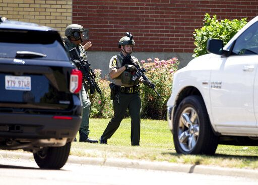 Law enforcement personnel respond to an active shooter at the Bunn-O-Matic warehouse on Stevenson Drive, Friday, June 26, 2020, in Springfield, Ill. Police say officers are searching for a gunman at a warehouse in the Illinois state capital after at least one person was shot and wounded. (Justin L. Fowler/The State Journal-Register via AP)