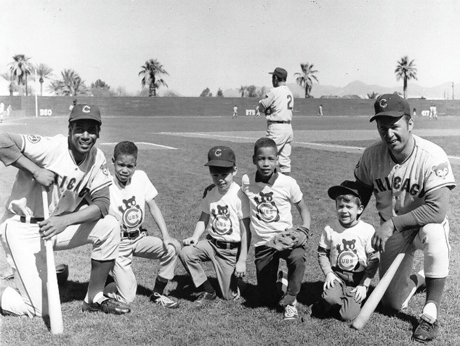 Ernie Banks, far left, and Ron Santo, far right, pose with their children during spring training in 1968 in Arizona. Cubs manager Leo Durocher is in the background. With Ernie are twins Jerry and Joey Banks. With Ron are sons Ron Jr., center, and Jeff.