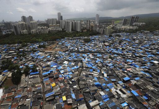 A general view of a slum area, some of which are containment zones, in Mumbai, India, Sunday, June 28, 2020. India is the fourth hardest-hit country by the COVID-19 pandemic in the world after the U.S., Russia and Brazil.