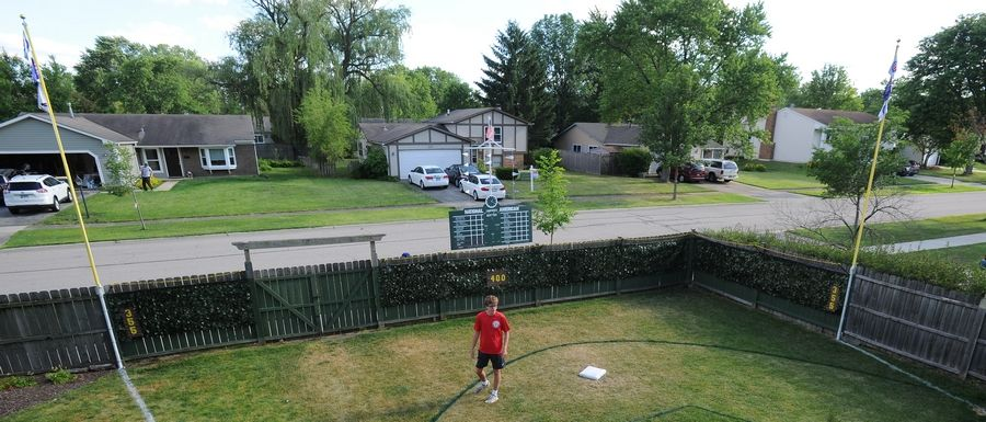 "D.J. Dick's backyard Wrigley Field Wiffle ball stadium measures 65 feet from home plate to a ""short porch"" at the right-field pole, 93 feet in the corner, 90 feet to center and 95 feet to left."