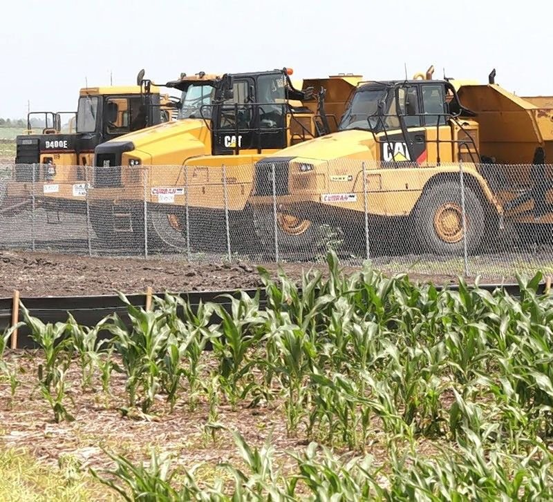 Construction equipment sits next to a cornfield on Crego Road near Gurler Road Monday ready to begin work on a project across from the ChicagoWest Business Center.