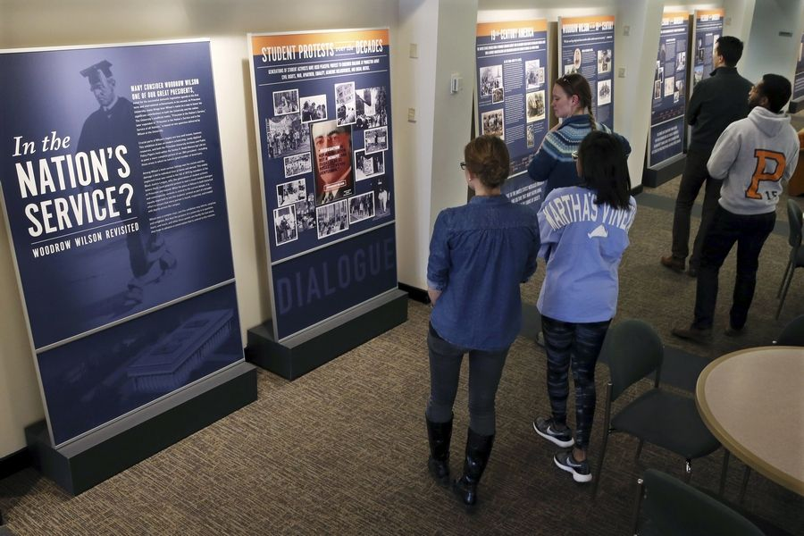 "Princeton University students walk through an exhibit titled, ""In the Nation's Service? Woodrow Wilson Revisited"" in 2016 at the former Woodrow Wilson School of Public and International Affairs in Princeton, N.J."