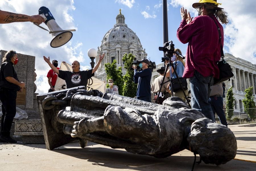 "People toppled this Christopher Columbus statue at the Minnesota state Capitol in St. Paul earlier this month. Once credited with ""discovering America,"" the Italian explorer has fallen out of favor amid accusations of tyranny and brutality."