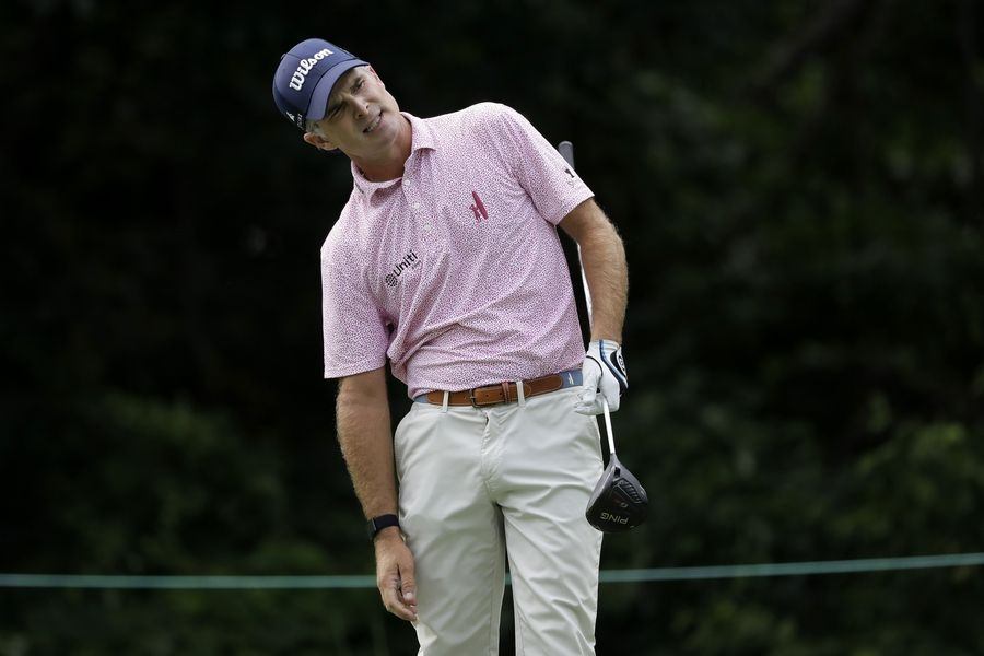 Kevin Streelman uses a little body English to get his tee shot to go where he wants on the 13th hole during the final round of the Travelers Championship Sunday in Cromwell, Conn. Streelman finished second by a shot, and credited two Wheaton golf courses with making him successful.