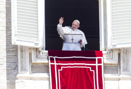 Pope Francis waves to the faithful at the end of the Angelus prayer from his studio window overlooking St. Peter's Square, after celebrating a Mass for the Feast of Rome's Patrons Saints Peter and Paul, at the Vatican, Monday, June 29, 2020.