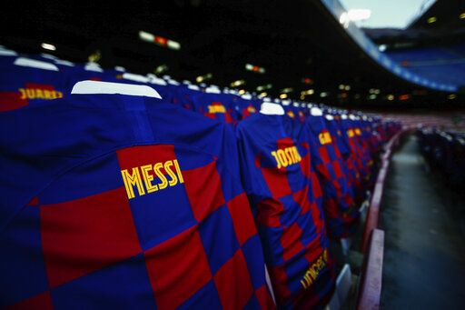FC Barcelona soccer shirts are displayed at the Camp Nou stadium stands prior the Spanish La Liga soccer match between FC Barcelona and Atletico Madrid in Barcelona, Spain, Tuesday, June 30, 2020.