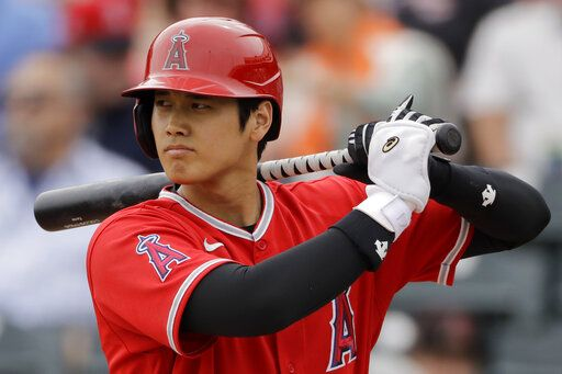 FILE - In this  Friday, Feb. 28, 2020 file photo, Los Angeles Angels' Shohei Ohtani bats during the first inning of a spring training baseball game against the Texas Rangers in Tempe, Ariz. Angels general manager Billy Eppler confirmed Tuesday, June 30, 2020 that Japanese star Shohei Ohtani will pitch and hit in the majors this season.