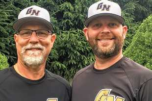 Grayslake North head baseball coach Brett Hill, right, poses for a picture with his dad, Rick. The Hills were scheduled to coach together this spring before the COVID-19 pandemic shut down the high school season.
