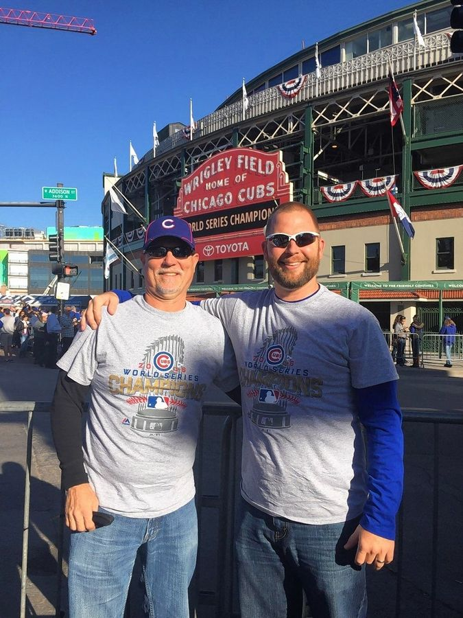 Grayslake North head baseball coach Brett Hill, right, poses for a picture with his dad, Rick, outside Wrigley Field. The Hills were scheduled to coach together this spring before the COVID-19 pandemic shut down the high school season.