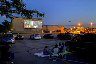 Marcus Cinema in Elgin shows drive-in double features from its parking lot throughout the summer.
